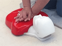performing CPR on a dummy