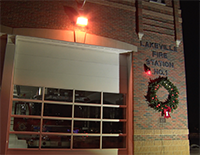 Lighted wreath hanging on Fire Station 1 building